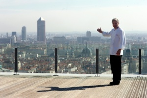 Chef Christian Tetedoie presenting the city of Lyon from his restaurant roof top